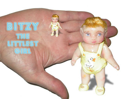 Bitzy the littlest girl fits on the palm of your hand like magic. Clay miniature.